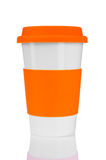 Orange travel mug Stock Photos