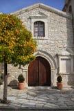 Orange tree and church in village Laneia Lania, Cyprus royalty free stock image