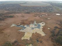 Marshland by village. An aerial view of marshland by a village stock photos