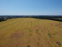 Marshland aerial. An aerial view of a marshland with a blue sky above it stock photography