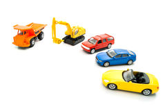 Orange truck, backhoe and other cars Royalty Free Stock Image