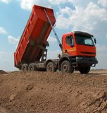 Orange truck dumper. On construction site Stock Photo