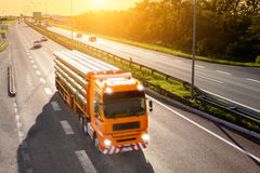 Orange truck in motion blur on the highway