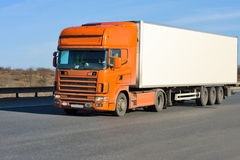Orange truck with white container Stock Photo