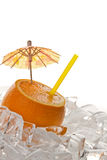 Orange with tube and ice Royalty Free Stock Photo