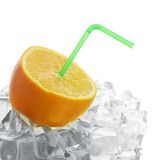 Orange with tube stands on ice cubes Stock Photo