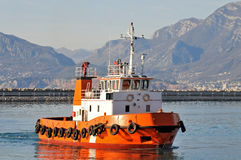 Orange tugboat Stock Photos