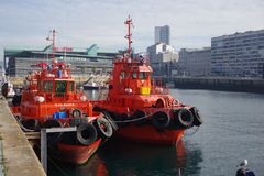 Orange tugboats waiting for job in port of Vigo, Vigo, Galicia, Stock Photography