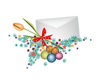 Orange Tulip in Envelope with Christmas Balls Royalty Free Stock Photography