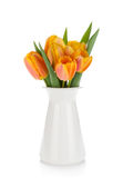 Orange tulips bouquet in flowerpot Stock Image