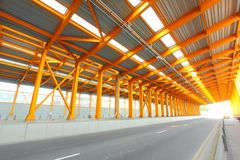 Orange tunnel at daytime. It shows the busy traffic in Hong Kong Stock Photos