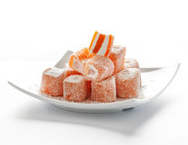 Orange turkisk fröjd med kokosnötflingor Arkivbild