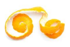 Orange twist of citrus peel. On white background Royalty Free Stock Image
