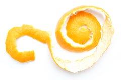 Orange twist of citrus peel. On white background Royalty Free Stock Photography