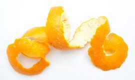 Orange twist of citrus peel. On white background Royalty Free Stock Photo