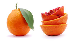Orange and Two orange squeezed. On white background Royalty Free Stock Photography