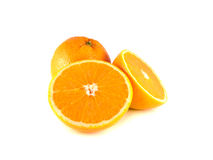 Orange with two sliced halfs  on white Royalty Free Stock Image