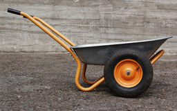Orange two weel wheelbarrow stock photo