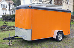 Orange Two-Wheel Trailer. Orange two-wheel positioned on lawn Royalty Free Stock Images