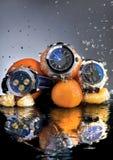 Orange Uhren Lizenzfreie Stockfotos