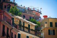 Orange umbrella in Italian mediterranean village Stock Images