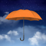Orange Umbrella on sky with clouds background Stock Photo
