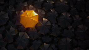 Orange umbrella standing out from crowd mass. Orange umbrella open and standing out from crowd mass black umbrellas, design background text concept, above point stock video
