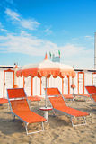 Orange umbrellas and chaise lounges on the beach of Rimini in It Royalty Free Stock Photography