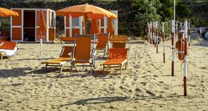 Orange umbrellas and chaise lounges on the beach of Vieste in Italy. The destination in the Adriatic coast apulia stock photography