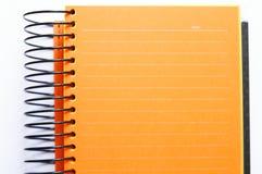Orange unbelegtes Notizbuch Stockfotos