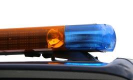 Orange und blaue Blinklichter des Polizeiwagens Lizenzfreies Stockfoto