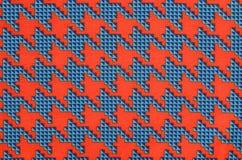 Orange und blaues houndstooth Muster Stockfotografie