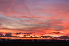 Orange und gelbe Landschaft des Himmels Stockfotografie