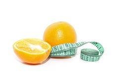 Orange und Maßband lizenzfreies stockfoto