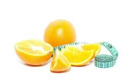 Orange und Maßband lizenzfreie stockfotos