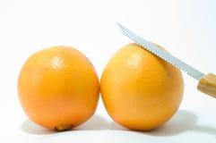 Orange und Messer Lizenzfreies Stockfoto