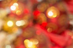 Orange und rotes bokeh Der Hintergrund mit boke Abstrakte Beschaffenheit Stockbilder