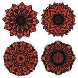 Orange und schwarze Kreisblumenmuster Stockfotografie