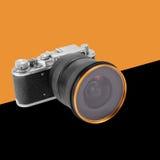 Orange und schwarzer Hintergrund der Retro- Filmkamera Lizenzfreie Stockfotografie