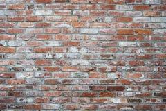 Orange und weiße Backsteinmauer Stockfoto