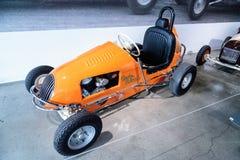 Orange 1949 Unidentified three fourth midget racer. Los Angeles, CA, USA — March 4, 2017: Orange 1949 Unidentified three fourth midget racer powered by a Royalty Free Stock Photos