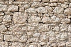 Orange vägg av ett löst stenslut upp Arkivfoton