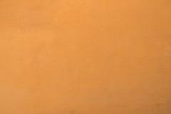 Orange väggtextur för cement Arkivbild