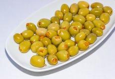 Orange välfyllda oliv 1 Arkivfoton