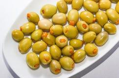 Orange välfyllda oliv Arkivbilder