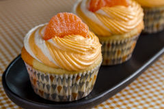 Orange Vanilla Bean Swirled Cupcakes Stock Photography