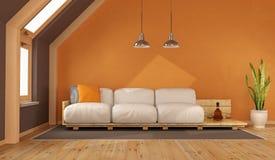 Orange vardagsrum i loften Fotografering för Bildbyråer