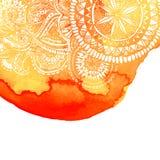 Orange vattenfärgborstewash med den drog vita handen Arkivbilder
