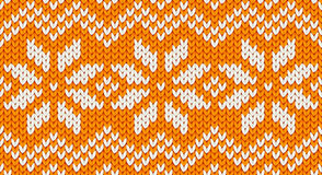 Orange vector realistic knit seamless pattern with white snowflakes and zig zag ornament Royalty Free Stock Images