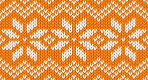 Orange vector realistic knit seamless pattern with white snowflakes and zig zag ornament Royalty Free Stock Photos
